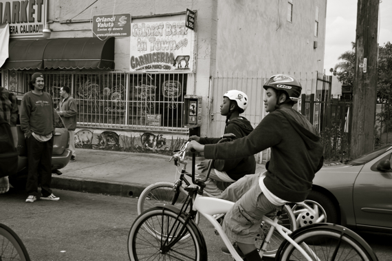 Best Friends: Frederick Buggs and Joshua Jones of the East Side Riders roll down Holmes Blvd. together. Sahra Sulaiman/LA Streetsblog