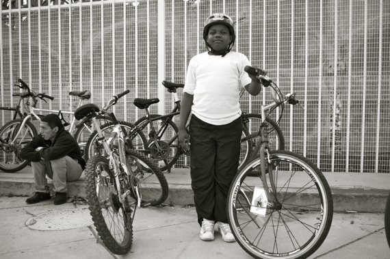 At ease, Soldier: A young member of the East Side Riders proudly poses with his bike at the Watts Towers. Sahra Sulaiman/LA Streetsblog