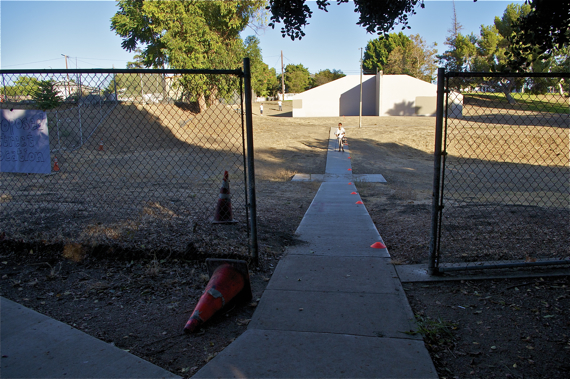 The extension of Norfolk St. would have passed between the cones on the sidewalk and the fence on the hillside on the left, requiring the removal of the handball courts. Sahra Sulaiman/LA Streetsblog