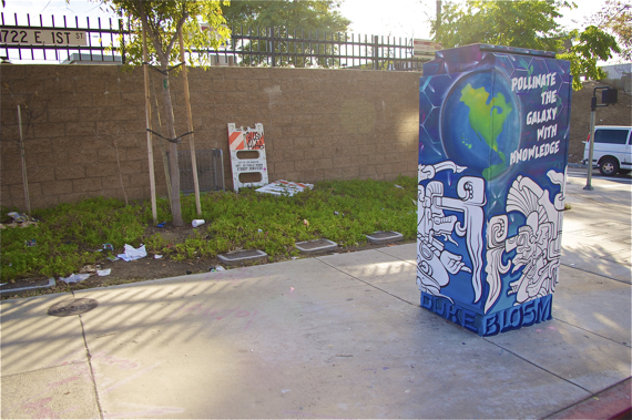 Garbage strewn behind the utility box suggests someone needs to take Blosm's message about pollenating the earth a little more to heart. Sahra Sulaiman/LA Streetsblog