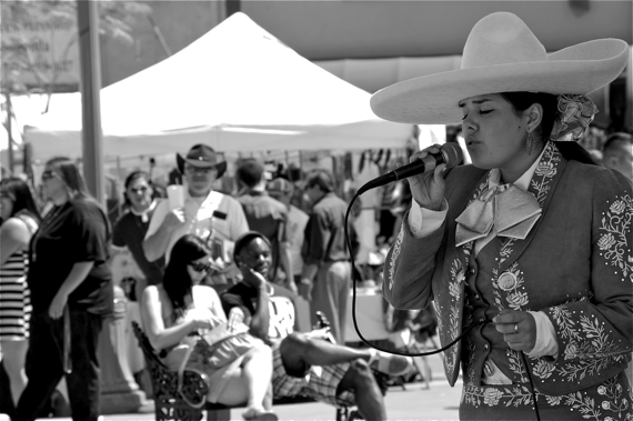 A woman sings boleros at a festival on Mariachi Plaza. Sahra Sulaiman/LA Streetsblog