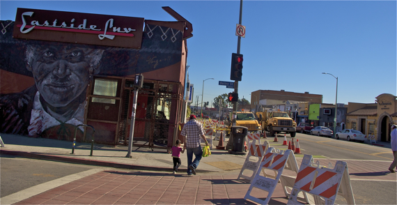 A man and his child navigate the construction along 1st St. in Boyle Heights. Sahra Sulaiman/LA Streetsblog