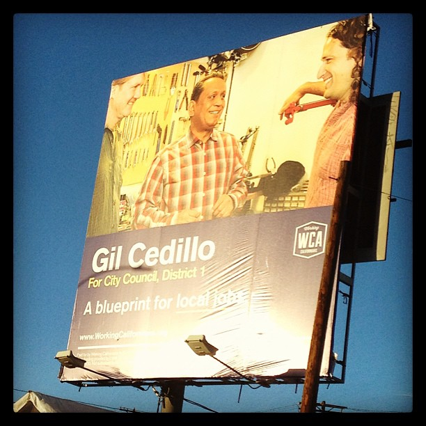 Gil Cedillo campaigned in the Flying Pigeon bike shop and used a picture with the owner in his campaign billboards. Now, Josef Bray-Ali is campaigning hard for Cedillo to fulfill a campaign promise to see bike lanes on North Figueroa Boulevard as the city's Bicycle Advisory Committee calls new studies a waste of time and money. Image: Flying Pigeon