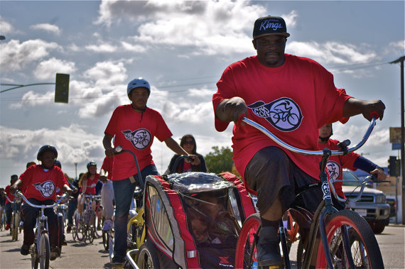 The East Side Riders' Ride4Love has always been about family, community, and service. Here, ESRBC co-founder Tony August-Jones brings his sons along while nephew Joshua Jones ensures they stay in the carrier. Sahra Sulaiman/Streetsblog L.A.