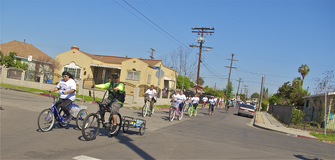 Javier Partida, founder of Los Ryderz, and long-time supporter Terri Calderon lead the pack toward Imperial Courts. Sahra Sulaiman/LA Streetsblog