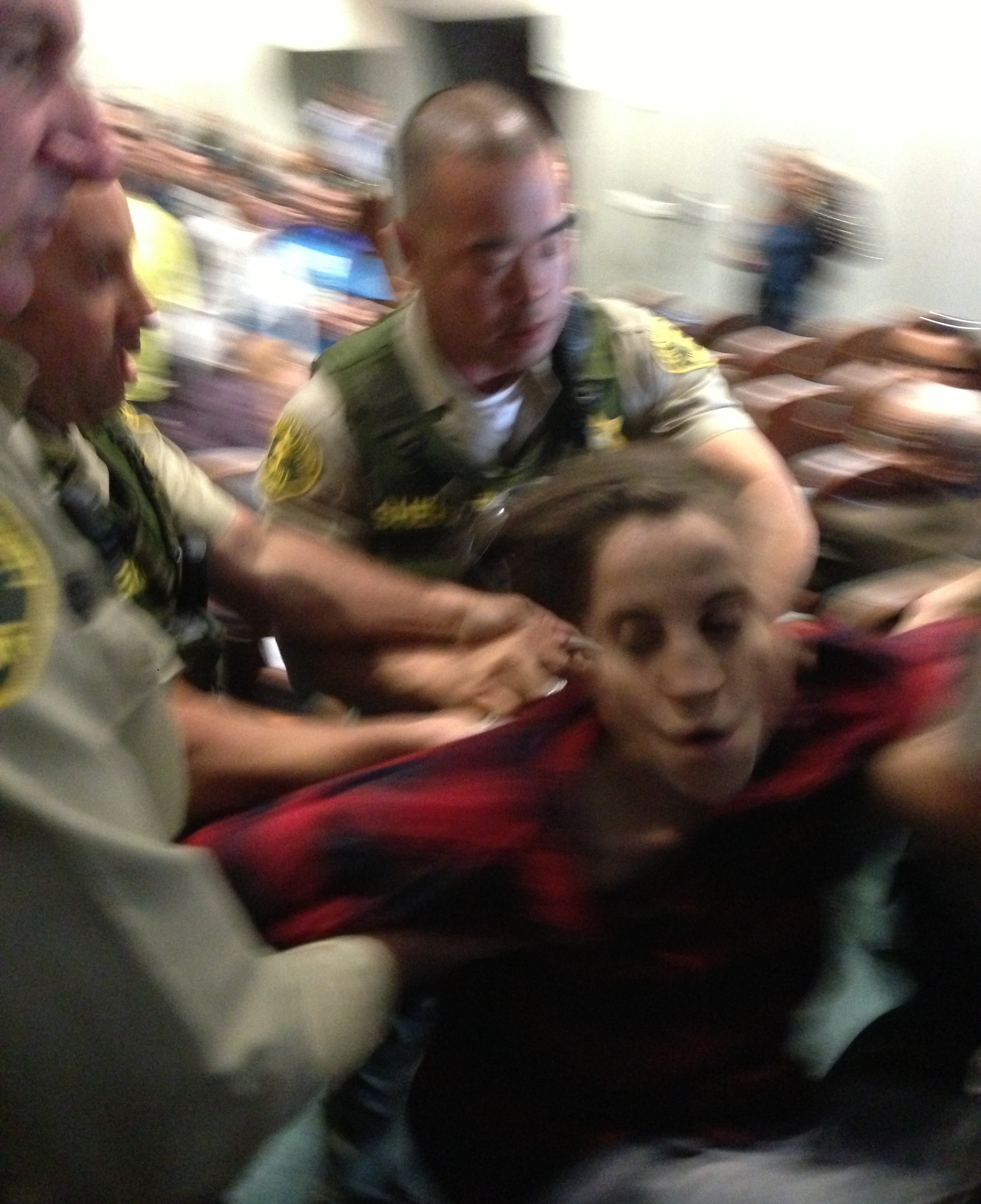"""Citing """"disruptive behavior"""" for prolonged public comment, uniformed officers removed two people from Metro's fare increase hearing.  photo: Joe Linton/Streetsblog LA"""