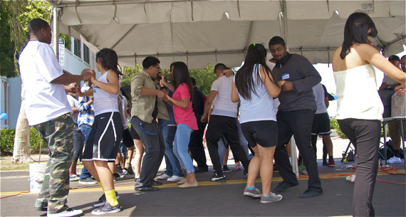 Students from Augustus Hawkins dance at the grand re-opening of Alba Snacks & Services. Sahra Sulaiman/LA Streetsblog