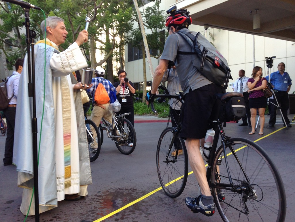 Eyes on the Street: Priest sprinkles holy water at the 11th annual Blessing of the Bicycles which took place yesterday at Good Samaritan Hospital. Photo: Joe Linton/Streetsblog LA