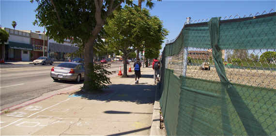 Youth walk home after school along the District Square site on Crenshaw Blvd. Sahra Sulaiman/LA Streetsblog