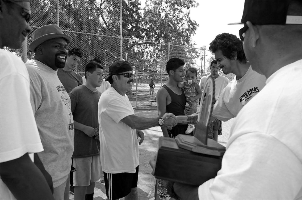The Woodshop Boys' coach is congratulated on their victory. JP (at right) holds the trophy he made himself. Sahra Sulaiman/LA Streetsblog