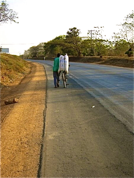 A maize farmer who has been in transit all day reaches the edge of Lilongwe (the capital) at sunset. Sahra Sulaiman/Streetsblog LA