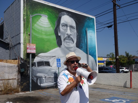 Artist Manny Velazquez shares the story behind the Danny Trejo mural in Pacoima. Photo Erick Huerta