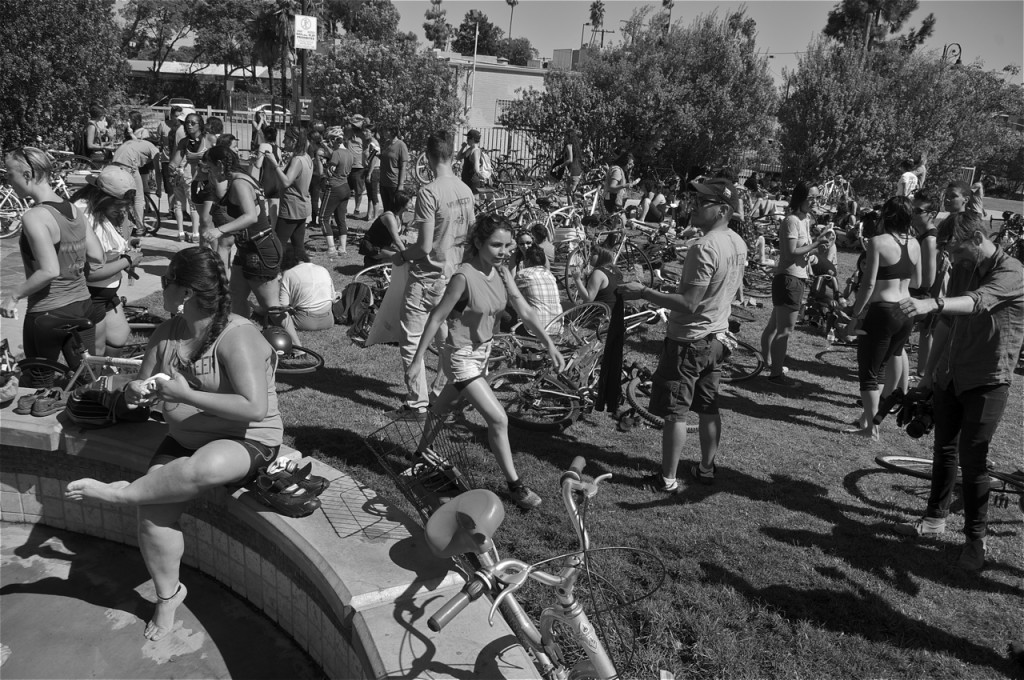 Riders rest in Glendale. A pit stop at Cerritos Park in Glendale included dancing to the beats of Buyepongo. Sahra Sulaiman/Streetsblog LA