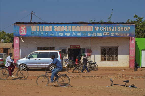 Bikes pass in front of a market stand near the center of Mchinji. Sahra Sulaiman/Streetsblog LA