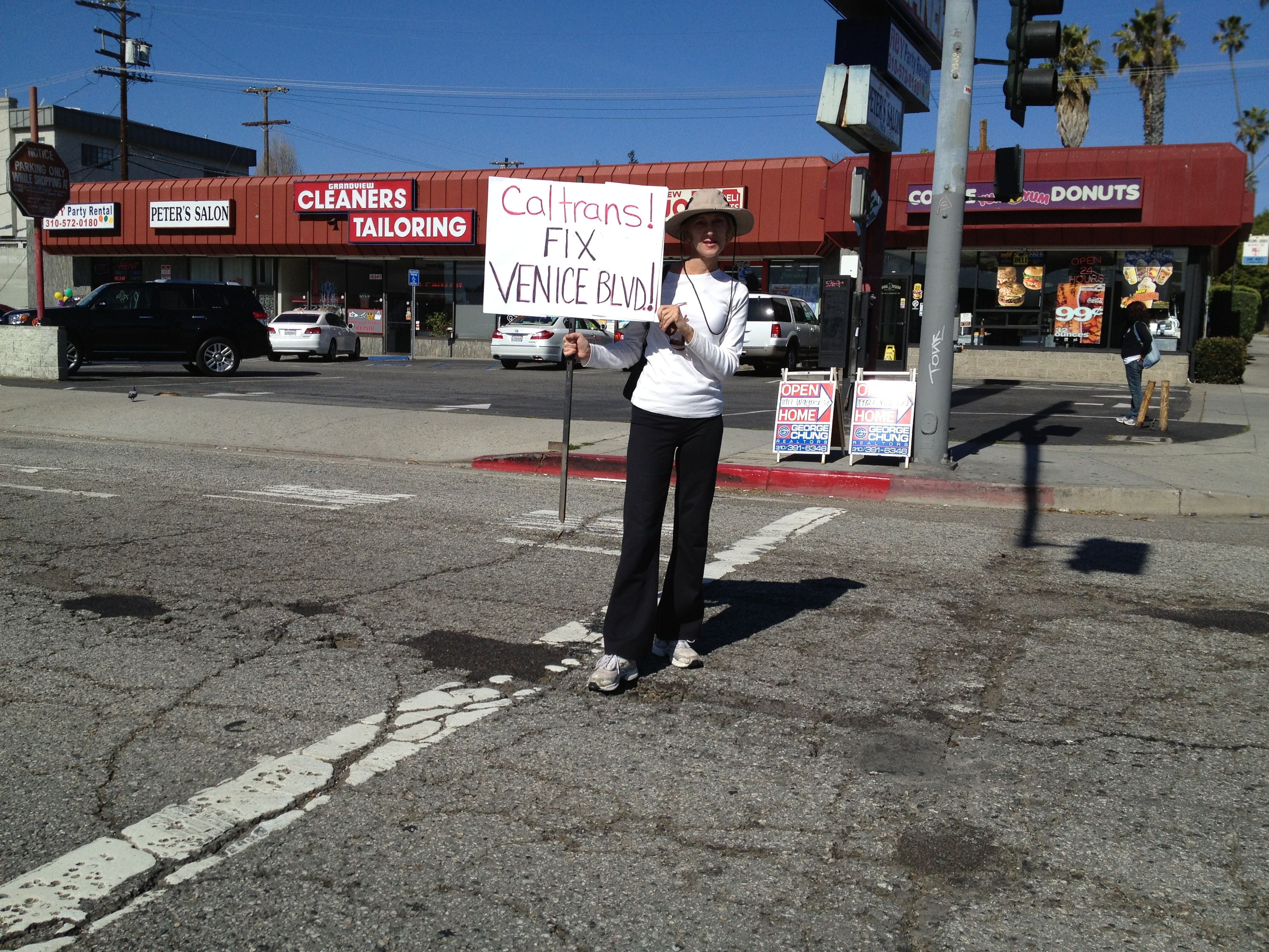 "Just a year and a half ago, Mar Vista residents held a protest over the poor state of Venice Boulevard. Bonin's and Garcetti's predecessors helped get portions of the road repaved before the 2013 ""CicLAvia to the Sea."" Photo: Mar Vista Mom"