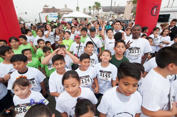 Runners in the Munchkin Half Mile gather at the start line. Photo: Eddie Ruvalcaba