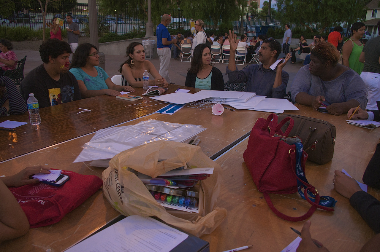 """Activarte participants discuss what """"home"""" means to them and prepare to make signs bearing their ideas. Sahra Sulaiman/Streetsblog LA"""