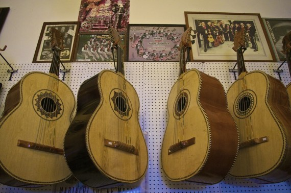 Guitarrones, a staple in a mariachi band, hang on the wall at Casa del Musico. Sahra Sulaiman/Streetsblog LA