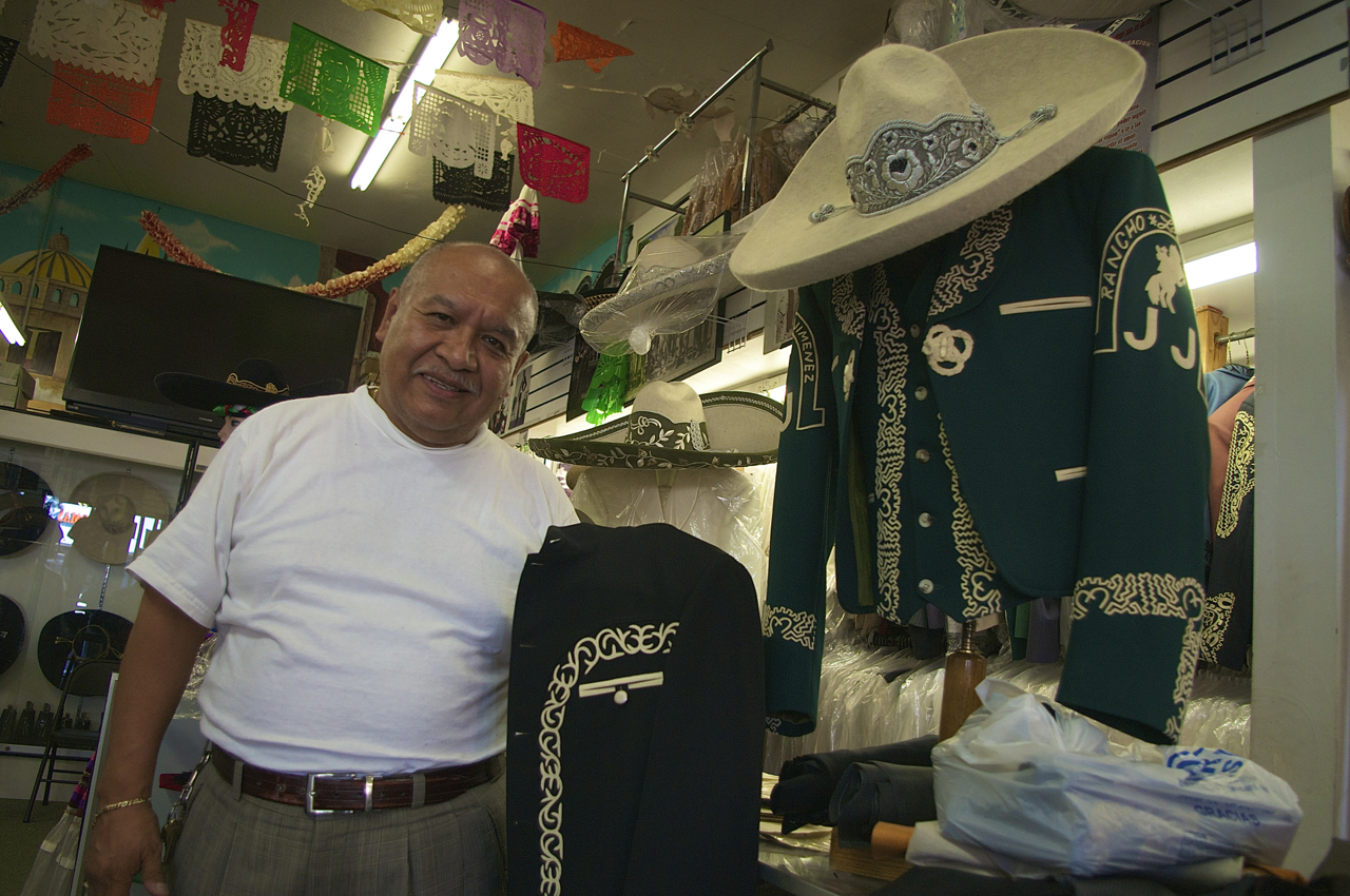 Don Jorge Tello shows off some of the detailing work he's done on jackets and sombreros. Sahra Sulaiman/Streetsblog LA