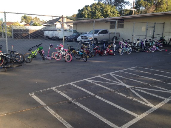 One kid. One kids bikes to school regularly. This was one of three bike storage areas on Friday