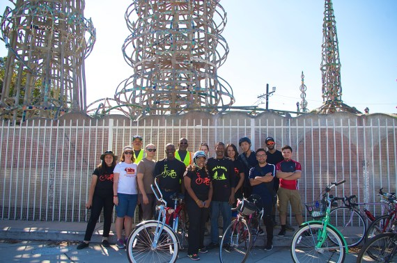 PELA members and members of the East Side Riders gather at the Watts Towers. Sahra Sulaiman/Streetsblog L.A.