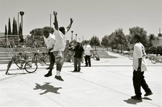 Why an after-party? Because riding bikes often makes people feel like this. The co-founders of the East Side Riders jump for joy at the Watts Towers. Sahra Sulaiman/Streetsblog L.A.