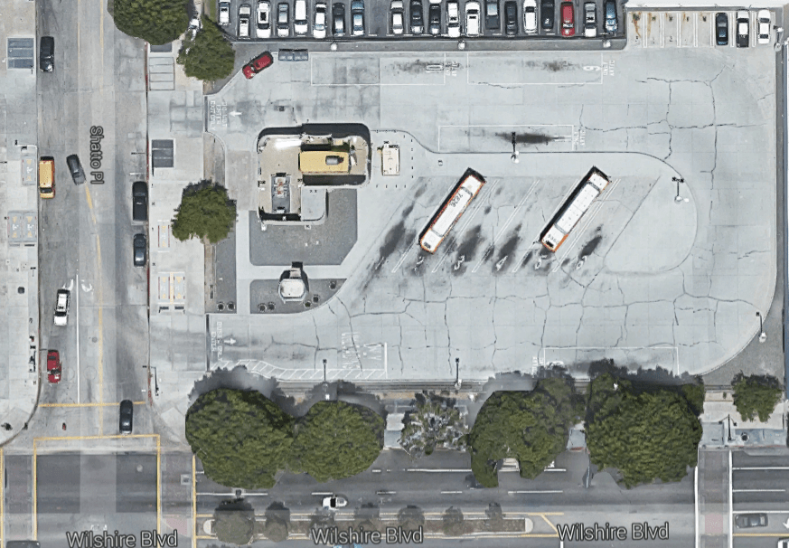 Metro should pursue joint development beyond the five rail lines under construction, including sites like this bus parking on Wilshire Boulvard just east of the Vermont/Wilshire station. Image via Google maps