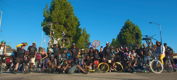 Members of the Black Kids on Bikes and their supporters gather for a photo during the MLK Day Parade along King Blvd. Sahra Sulaiman/Streetsblog L.A.
