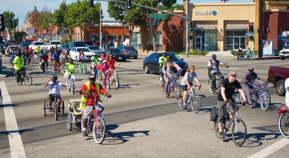 The tail end of the group heads into South Gate along Firestone Blvd. Sahra Sulaiman/Streetsblog L.A.
