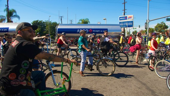 Riders make way for a delivery of gasoline to the am/pm station. Sahra Sulaiman/Streetsblog L.A.