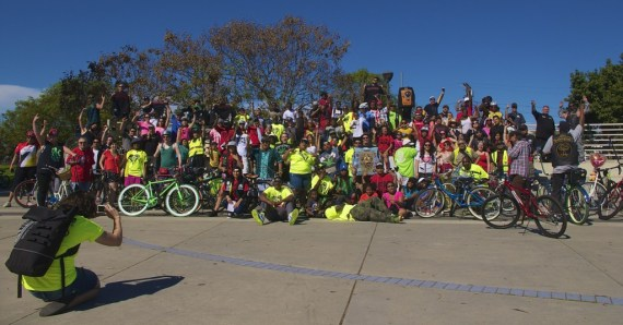 Riders gather for a photo at the Watts Towers. Sahra Sulaiman/Streetsblog L.A.