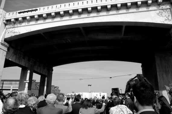 Mayor Eric Garcetti (center, facing camera) addresses a crowd of city notables under the 6th St. Viaduct. Sahra Sulaiman/Streetsblog L.A.