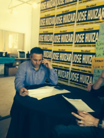 Joe Buscaino, who received more votes in his Streetsie race against Huizar than Molina did in her City Council race, works the phone lines yesterday.