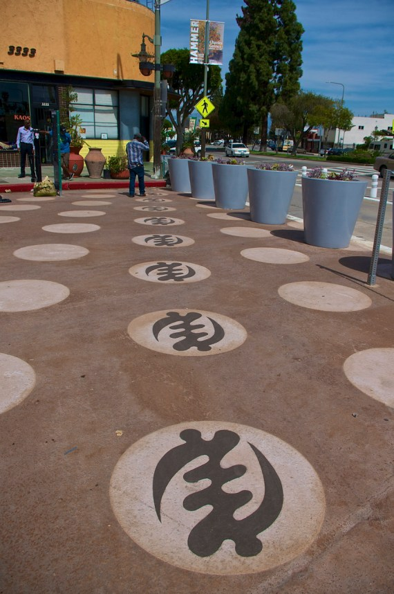 All roads lead to KAOS. The Gye Nyame symbols were the first to be set down. Sahra Sulaiman/Streetsblog L.A.