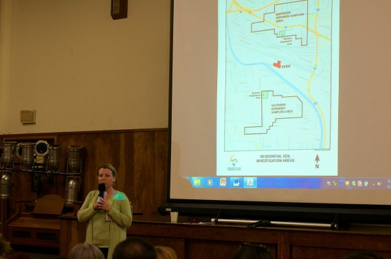 DTSC Director Barbara Lee stands beneath the map of the two assessment areas (the two green squares deemed most likely to have been affected by lead emissions) and the expanded assessment areas, where current sampling for lead contamination was currently underway (areas outlined in black). Sahra Sulaiman/Streetsblog L.A.