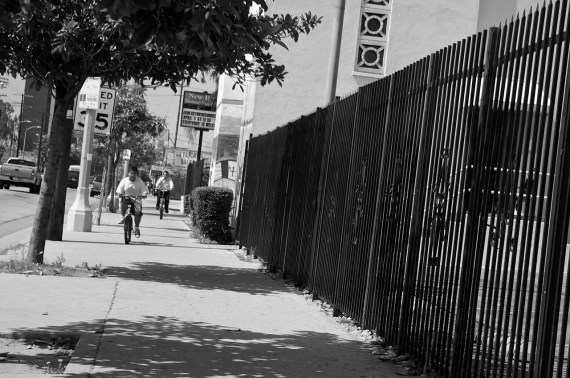 A father and son ride their bikes along Central Avenue's sidewalks on a Sunday afternoon. Sahra Sulaiman/Streetsblog L.A.