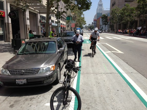 Officer Guerra and Sgt. Smith ticketing a parking violation on Spring Street. All photos by Joe Linton/Streetsblog L.A.