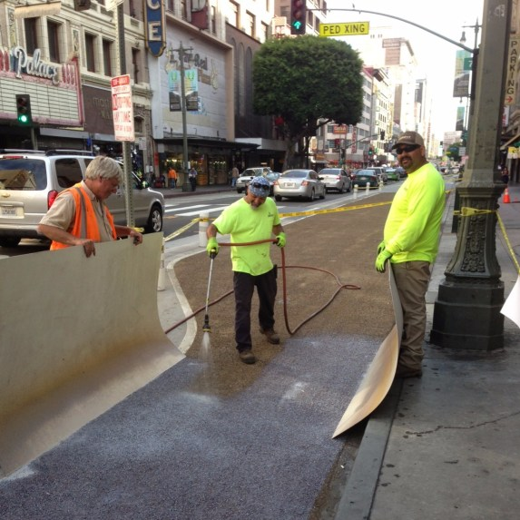 Installation of Broadway's epoxy-aggregate surface in 2014