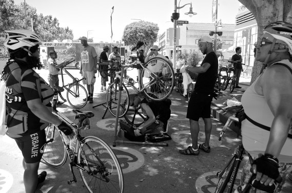 The founders of the Ride On! bike co-op and members of Black Kids on Bike gather in Leimert Park to host an open-air tune-up session. Sahra Sulaiman/Streetsblog L.A.