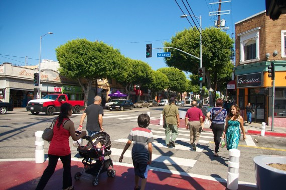 Pedestrians cross at St. Louis and Cesar Chavez, where new bulb-outs were recently installed by the Great Streets program. Sahra Sulaiman/Streetsblog L.A.
