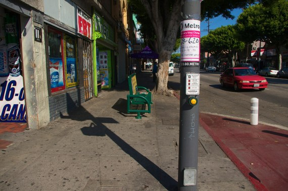 The original bus stop at St. Louis and the notice of the change. The bollard at right blocks bus access. Sahra Sulaiman/Streetsblog L.A.