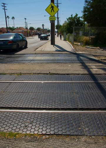 There are no pedestrian barriers at Gage Ave., even though the tracks run adjacent to a park heavily used by children. Sahra Sulaiman/Streetsblog L.A.