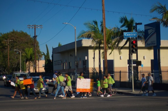 Members of the South Central community head for the CD9 Constituent Center chanting in favor of safe streets and bike lanes. Sahra Sulaiman/Streetsblog L.A.