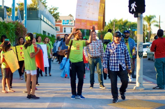 Community members head back to the intersection of Vernon and Central to hold a press conference. Sahra Sulaiman/Streetsblog L.A.