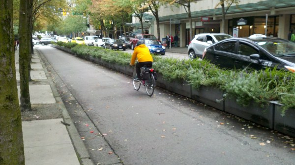 A planter protected bikeway in Downtown Vancouver is wide enough for a fire truck.