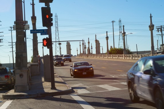 4th is in need of curb cuts. If you are in a wheelchair, pushing a stroller or cart, or on a bike, you have several steep curbs to navigate if you want to make it across the bridge. Sahra Sulaiman/Streetsblog L.A.