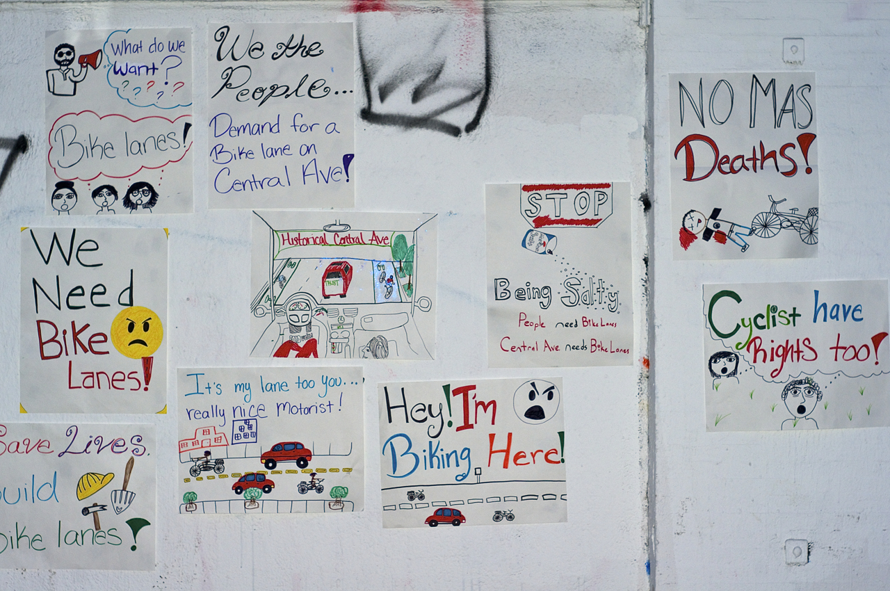Posters created by South L.A. community members adorn the walls outside of TRUST South L.A. Sahra Sulaiman/Streetsblog L.A.