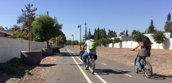 Cyclists riding the West Santa Ana Branch bike path in the city of Bellflower