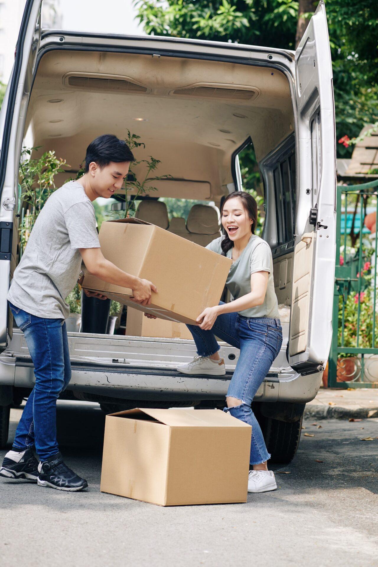 Couple unloading truck