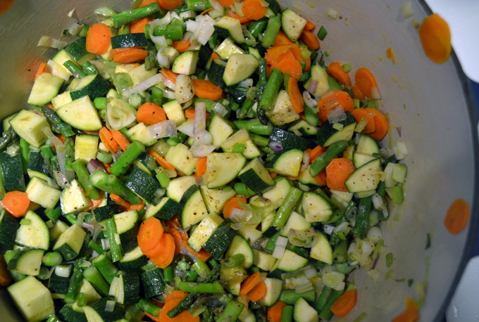 The sautéed vegetables for Summer Vegetable Soup should retain their bring colors   labellasorella.com